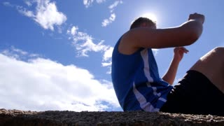 Male Sport Athlete Doing Sit-Ups Outside