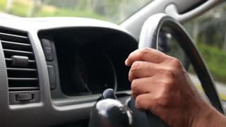 Man Driving a Car, Hands on Steering Wheel Close-up.