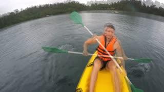 Man Kayaking in the Lake. Timelapse.