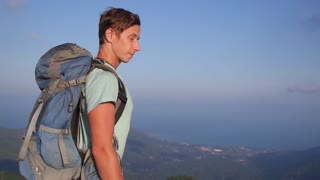 Man Traveler with Backpack Hiking Travel Lifestyle Concept