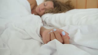 Man Waking Up His Woman in Bed in Morning. Love and Care.