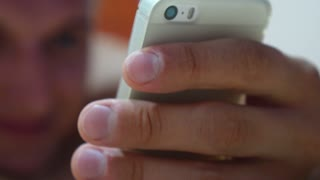 Man's Hand Using Mobile Cellphone Closeup