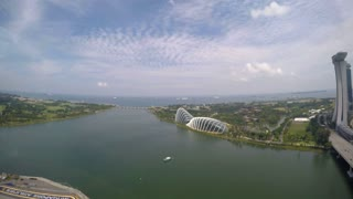 Marina Bay Sands, Gardens by the Bay from Singapore Flyer Wheel. Timelapse.