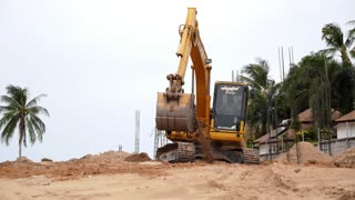 Mechanical Digger on the Beach. Speed up.