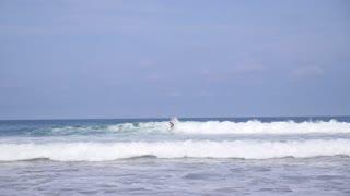 Men Surfing on Wave in Blue Ocean, Indonesia, Bali. Slow Motion