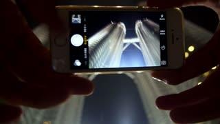 Mobile Phone Shoot a Photo of Petronas Twins Towers