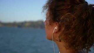 Motivational Uplifting Close Up Video of Young Beautiful Woman Enjoying Music On Earphones. Slow Motion.