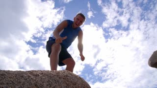 Motivational Winner Man at Top of Mountain at Sky