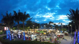 Night Market with Tourists. Time Lapse.