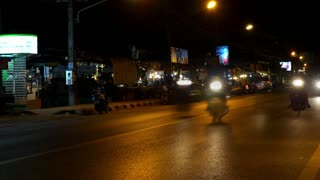 Night Road Traffic with Cars and Motorbikes. Time Lapse.