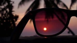 Ocean Sunset Through Sunglasses on Beach with Palm Trees