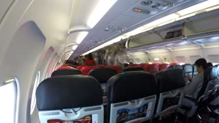 Passengers Boarding in Airplane. Aircraft Interior. Time Lapse.