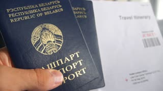 Passports, E-Ticket and Boarding Pass with Travel Itinerary