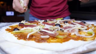 Pizza with Ham, Pepperoni, Pepper, Mozzarella and Olives