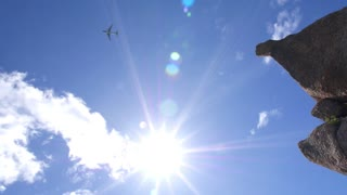 Plane Flying in Blue Sky in Sunny Day