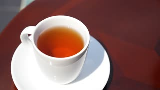 Pouring Black Tea in the Cup Outdoor