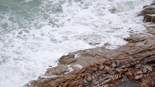 Powerful Waves Crashing against the Rocks. Slow Motion.