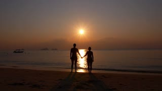 Romantic Couple Holding Hands and Enjoying Beach Sunset.