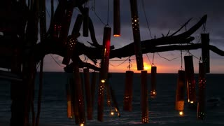 Romantic Lanterns on Beach at Sunset