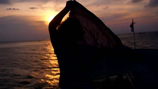 Romantic Woman Traveling by Boat at Sunset. Slow Motion.