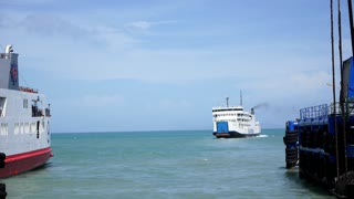 Sailing Ferry in Harbor. Ferryboat Leaving Pier. Speed up.