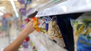 Shopping. Woman Choosing Healthy Food in Supermarket