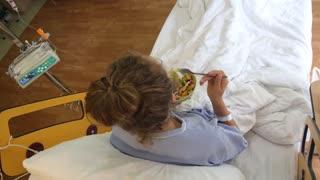 Sick Woman Eating Healthy Salad in Hospital