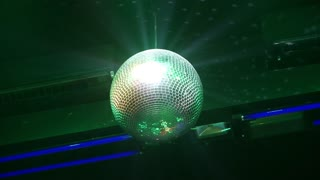 Silver Disco Ball Spinning in Nightclub