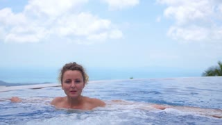 Spa Wellness - Woman Relaxing in Whirlpool Jacuzzi Outdoor