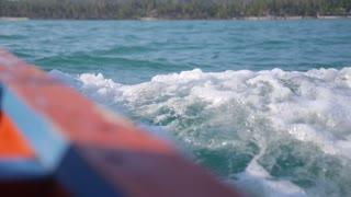 Splashing Sea Waves Overboard of Sailing Motor Fishing Boat