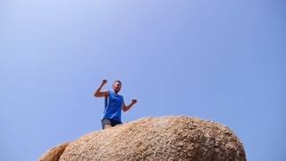 Sport Man Celebrate Success on Top of Mountain.