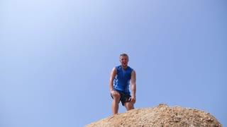 Sport Success Motivation Man Raising Arms after Cross Track Running
