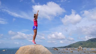 Sport Woman Reaching the Top of Mountain. Slow Motion.