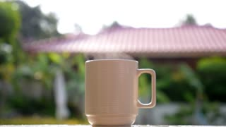 Steaming Coffee Cup Outdoors.