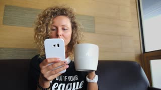 Stylish Hipster Woman With Coffee Using Mobile Phone