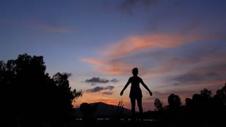 Success Concept of Woman Silhouette with Arms Outstretched