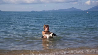 Summer Vacation - Girl with Dog in the Sea