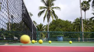 Tennis Court on Tropical Island. Tennis Balls Slow Motion.