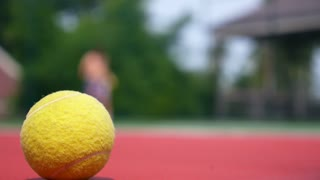 Tennis Player in Action on Tennis Court. Focus on Ball.