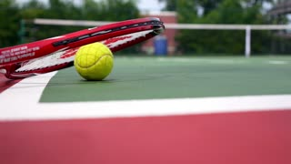 Tennis Racket and Balls on the Tennis Court. Close up.