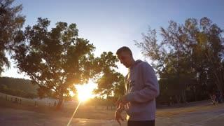 THAILAND, KOH SAMUI, APRIL 2015 - Young Man Playing Basketball at Dramatic Sunset. Slow Motion.