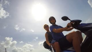 THAILAND, KOH SAMUI, FEBRUARY 2015 - Happy Young Couple on Motorbike Driving Together and Enjoying the Trip