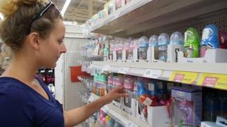 THAILAND, KOH SAMUI, JANUARY 2015 - Young Pregnant Woman Choosing Baby Stuff at Baby Shop Store