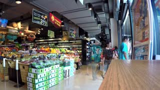 THAILAND, KOH SAMUI - MAY 06, 2015: Supermarket Interior with Shopping Customers or Buyers. Time Lapse.