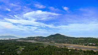 Top View of Island Takeoff Strip against Blue Sky. Timelapse.