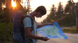 Traveler with Backpack and Tourist Map on Road