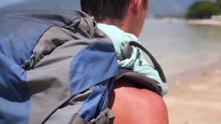 Traveling Backpacker Shoulder. Active Lifestyle Concept. Traveler on Beach.