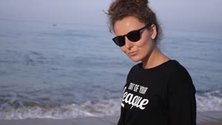 Trendy Fashion Girl in Sunglasses at Beach on Vacation at Sea