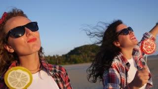 Trendy Girls Enjoying Summer Sunset with Sunglasses