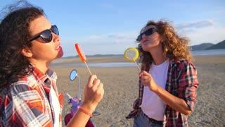 Trendy Summer Girls with Lollipop on Beach
